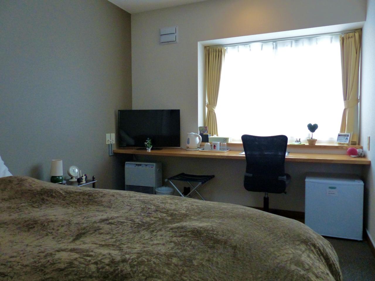 落ち着いたインテリアの客室。津軽海峡を望める。